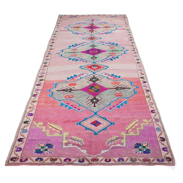 Vintage unique colorful wool rug from Hakkari region of Turkey. Approximately 65-75 years old. In very good condition.