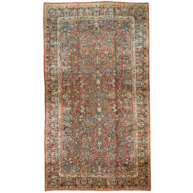 """An antique Sarouk rug with an intricate pattern. Measurement: 12' x 21'6"""""""