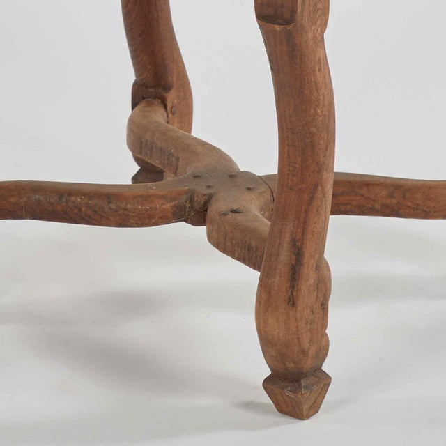 Wood stool upholstered in dark brown leather from late 19th century France.