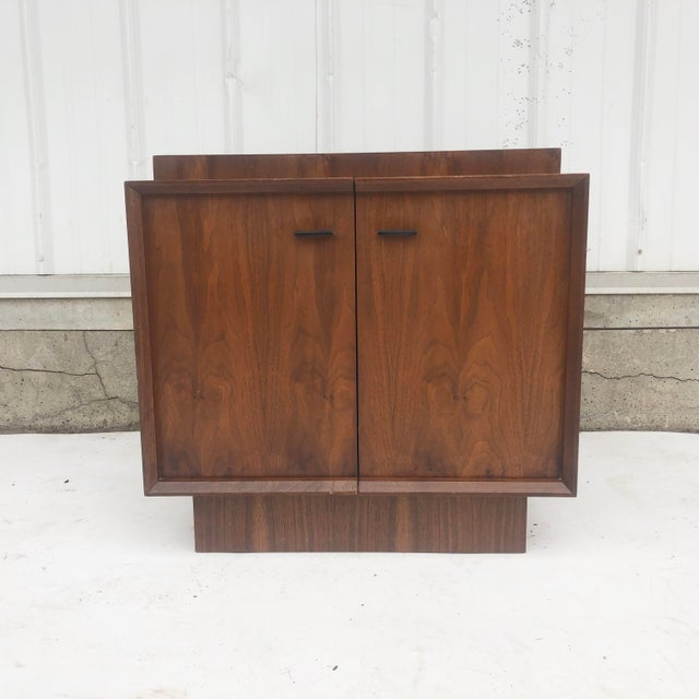 Classic mid-century modern style is showcased in this simple yet substantial vintage nightstand. Spacious interior storage...