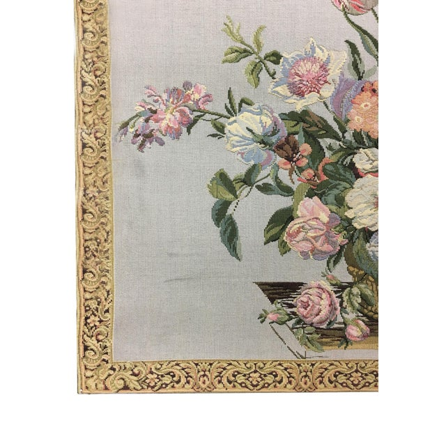 This large, stunning example of English Tapestry features a colorful basket of blooming flowers. Traditionally, large...