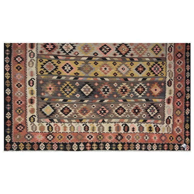 This beautiful vintage 100% wool kilim is handmade in Iran, Azarbayjan region. It features a geometric pattern in a...