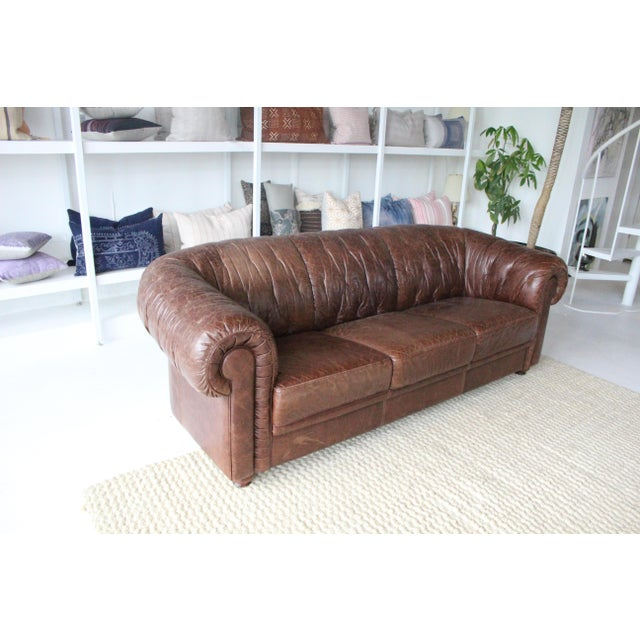 Vintage italian leather sofa. No buttons. In very good shape. Leather shows some wear but not ripping in leather.