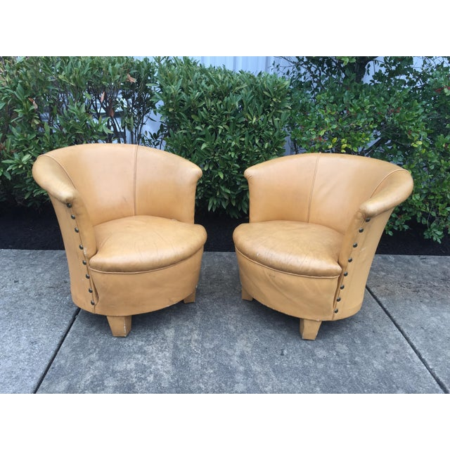 Fabulous pair of mid-century Spanish barrel back leathers chairs, in original leather upholstery. Great vintage design and...