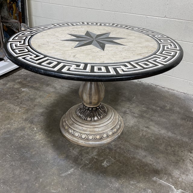 This is a great table! Could be used as a dining table, game table or entryway table! Tessellated stone top with star and...