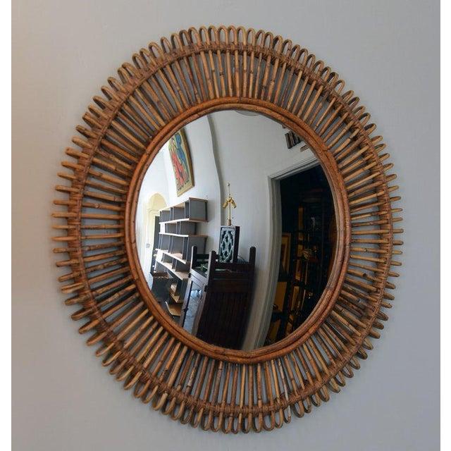 The 'Oculus' round rattan convex mirror. Convex mirror inserted into a round rattan frame.
