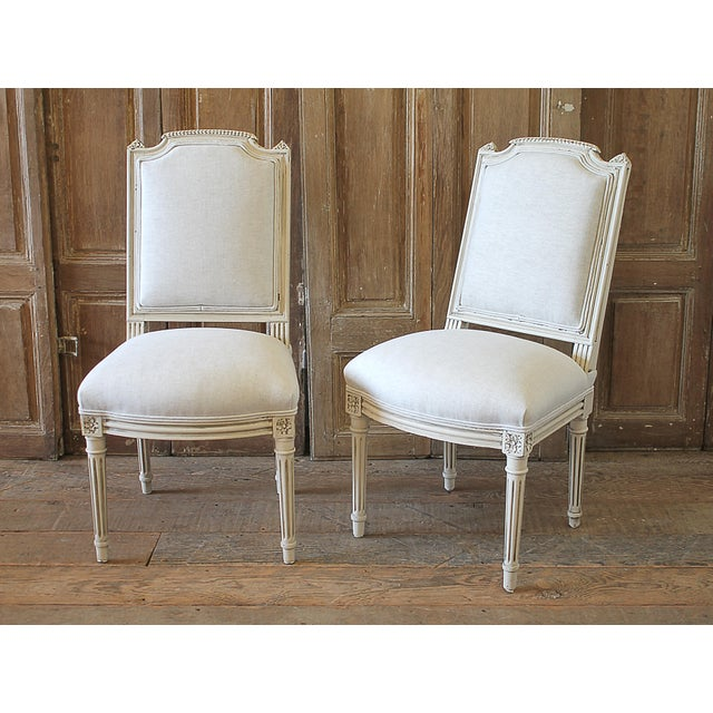 Early 20th Century Pair Of Painted And Upholstered Louis XVI Style Childs Chairs SKU Number: 1029-1893209 Very petite 20th...