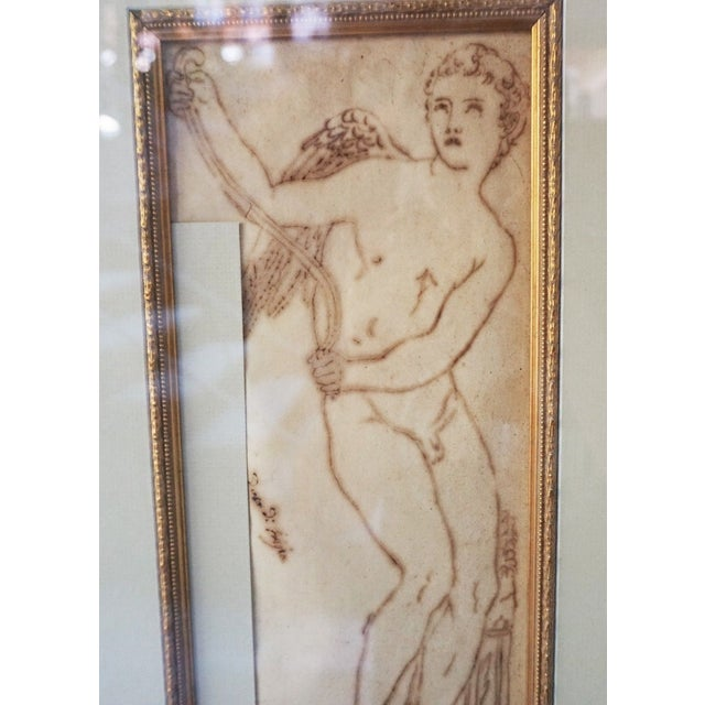 Presented here is a STUNNING Antique Framed Italian Pen and Ink Drawing of an Infant Cupid. This amazing drawing poertrays...