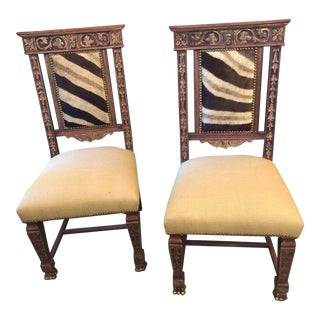 Early 20th Century Vintage Carved Side Chairs W/Hide Upholstery For Sale