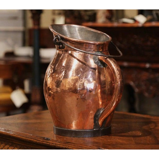 Decorate a kitchen top cabinet with this antique coal bucket. Crafted in France, circa 1860 and made of copper with two...