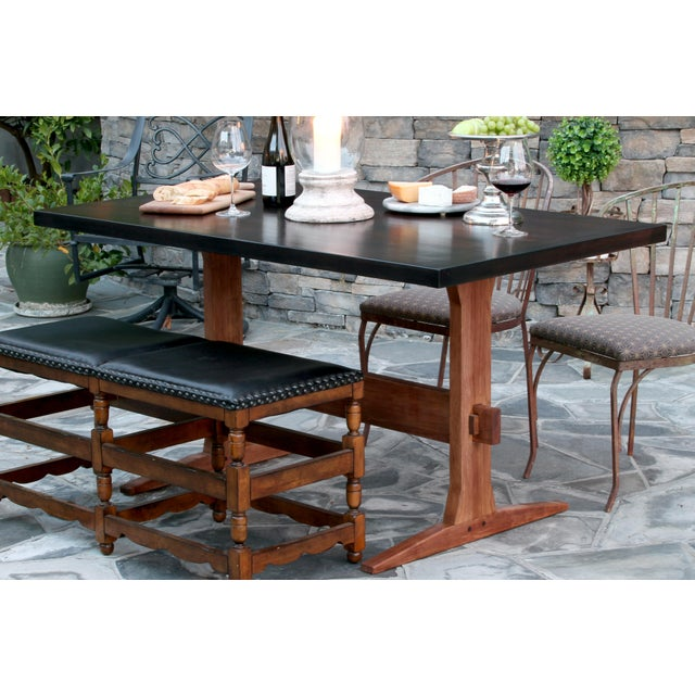 This handcrafted knockdown farmhouse trestle table is made of solid hickory and Baltic birch. The top is stained in a dark...