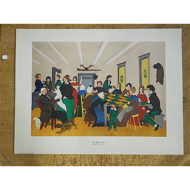 This double elephant size antique lithograph depicts a group of people enjoying themselves at a quilting party in the late...