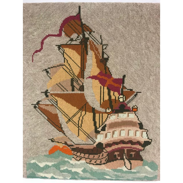 A gorgeous English needlepoint wall hanging of a full-masted ship at full sail and with flags fluttering. Found at a flea...