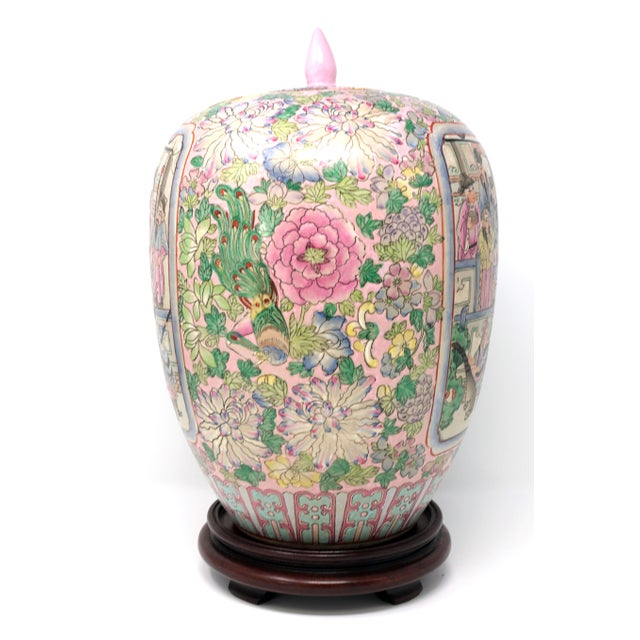 A beautifully detailed, hand-painted temple jar, depicting a warring Chinese family surrounded by various colorful...