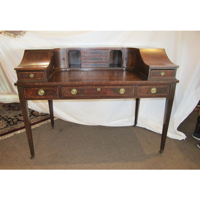 This antique Sheraton style 'Carlton House' desk is good quality & is a 20th century copy of this famous design. I would...