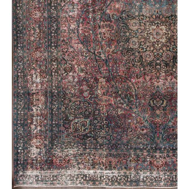 Antique hand-knotted Persian Tabriz distressed rug with an all-over motif. This piece has great detailing and a beautiful...
