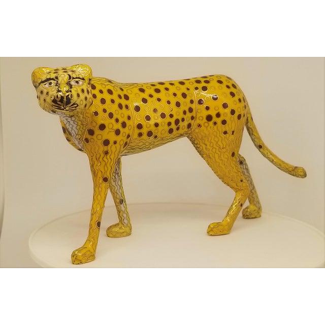 Offering a stunning vintage cloisonné Cheetah sculpture, circa 1980s. This cloisonné enamel and brass figurine sculpture...