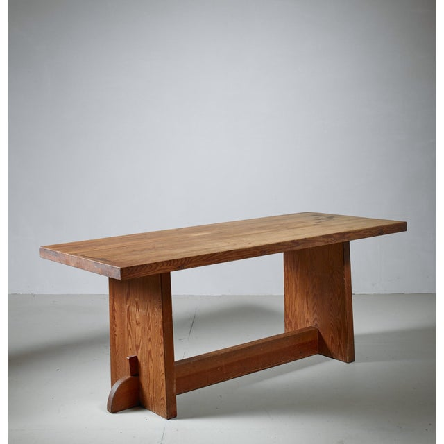 A pine model 'Lovö' dining or console table by Swedish designer Axel Einar Hjorth for Nordiska Kompaniet with a...