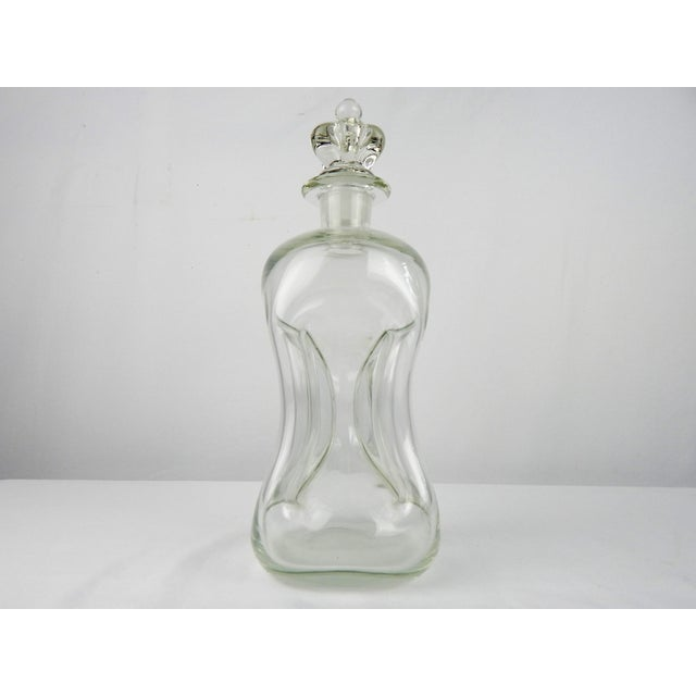 Vintage pinch crystal decanter with crown-shaped stopper. No hallmark.