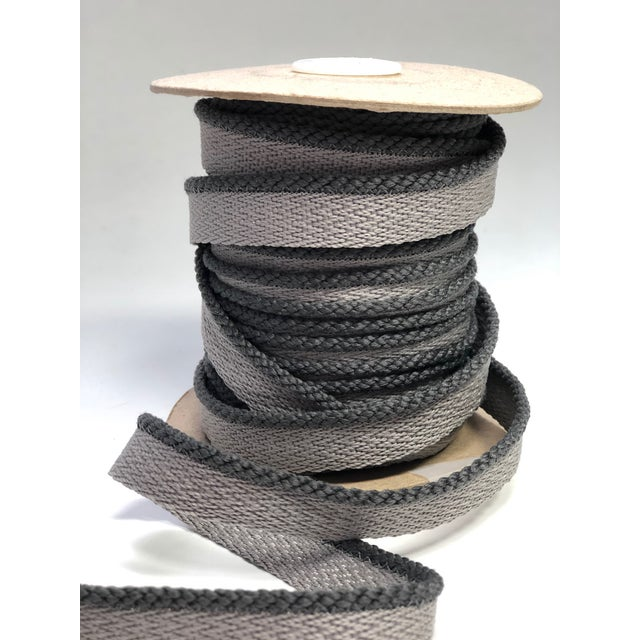 """One 22 yard (20 meter) spool of 1/8"""" (3mm) braided cord with flange. Color: mid-tone gray Flange is 1/2"""" wide for sewing...."""