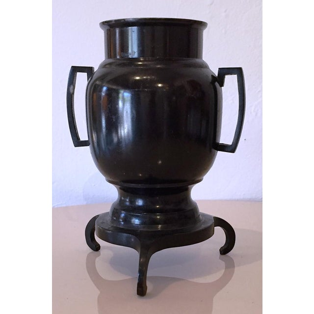 Solid bronze Ikebana vase has 3 legs and a pair of handles. Traditional Japanese style and material the vase is mid-...