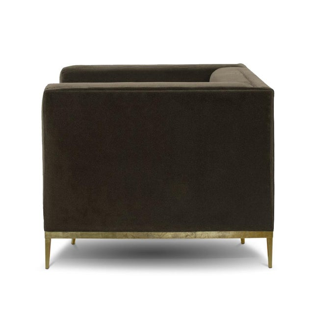 This original BOND lounge is upholstered in mohair velvet. The base is finished in brass, and supports a solid oak frame...