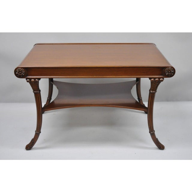 Nancy Corzine Mahogany French Regency Style Saber Leg Coffee Cocktail Table. Item features solid wood construction,...