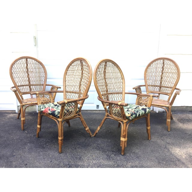 This stylish set of four vintage bamboo chairs feature dramatic high backs, rounded arm rests, and comfortable seat...