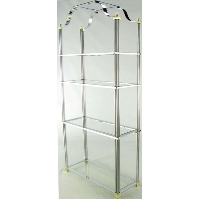Chrome and brass four shelf etagere with excellent understated details. Each shelf is supported by 12 chromed bars with...