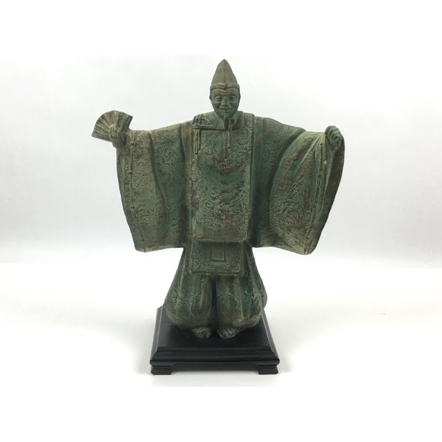 Vintage, 1981, bronzed Chinese Emperor statue crafted by Austin Productions. Bronzed and painted composite with a...