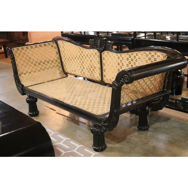 Ebony Settee from Sri Lanka. Hand carved and caned.