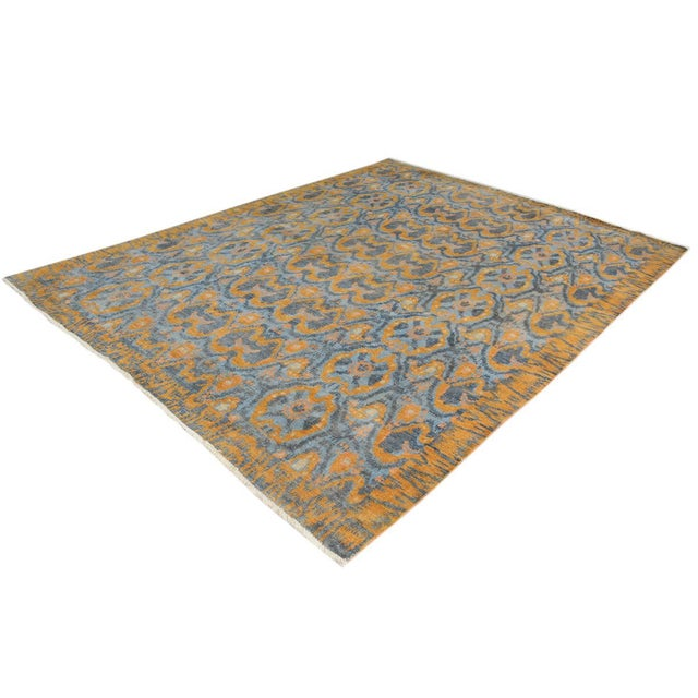 Modern hand knotted rug made with luxurious wool is a refreshing addition to your décor. Mesmerizing Intricacy and...
