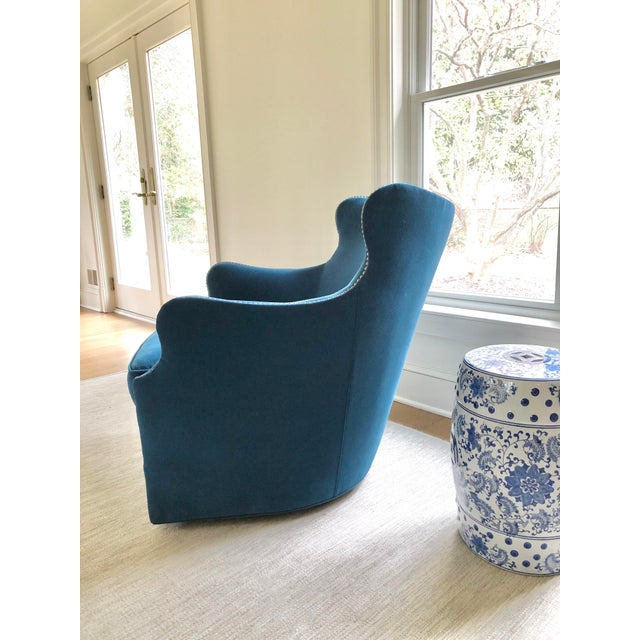New swivel chair from Lee Industries, upholstered in a family friendly Crypton peacock blue velvet. Natural brass nailhead...