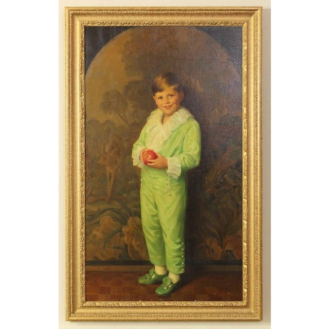 An outstanding life-size oil on canvas portrait of a young boy dressed as a page in a green silk costume holding an apple,...
