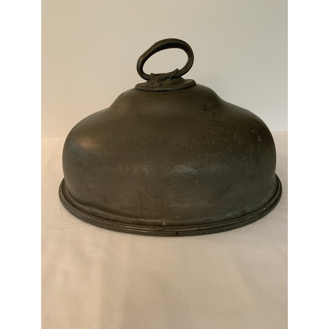 """These are a pair of James Dixson & Sons pewter meat covers. There is a large one that measures 16 1/4"""" long x 12 1/2"""" wide..."""