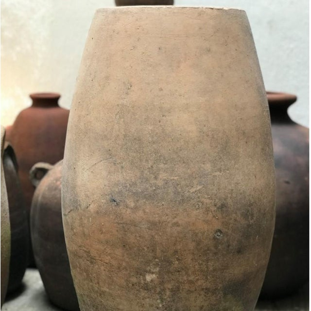 Carmen is a tall vintage terracotta vessel discovered in a potters studio in the region of Jalisco, Mexico. This...