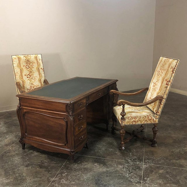 Grand 19th Century Louis XIV Walnut Partner's Desk will make an executive's office the talk of the company! Featuring...