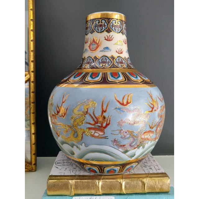 The color on this vase are unusual, chocolate and turquoise, and beautiful. This is a high quality piece, with embossed...