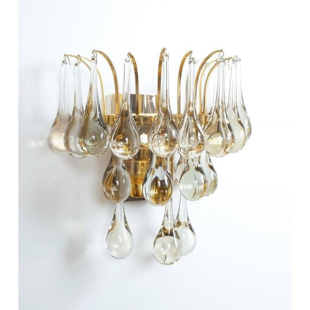 Beautiful multi-tiered set of four Murano glass tear drop sconces, 1960 composed of a multitude of handblown smooth Murano...