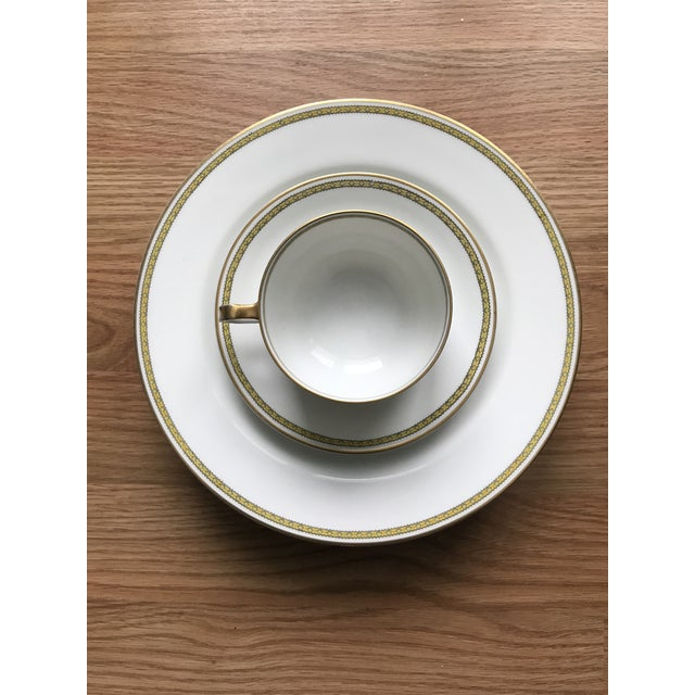 """A gorgeous set of Limoges bone china. 11 pieces including 4 plates (8.75"""" diameter), 5 saucers, and 2 teacups. A beautiful..."""