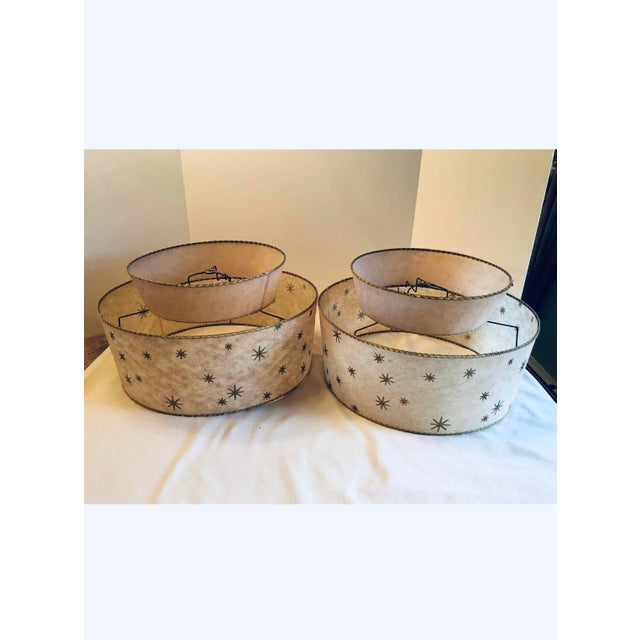 Wonderful pair of all authentic mid century modern fiberglass lampshades in a gold starburst atomic pattern. These great...