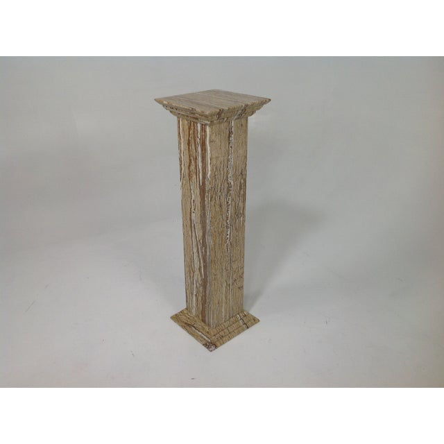 """Beautiful travertine plant or statue stand. The stand is stunning and has never been used. The stand is 40"""" tall and 12"""" X..."""