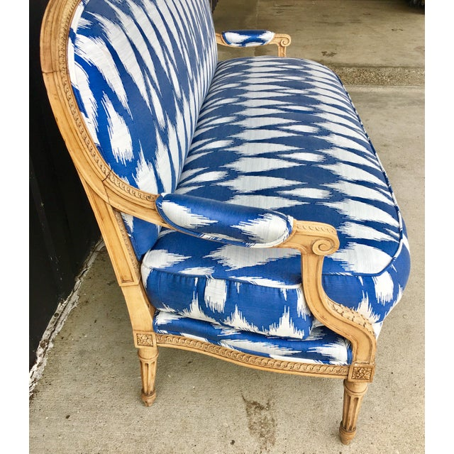 Vintage 1930's settee/sofa. Brand new upholstery in a modern graphic periwinkle blue and white print. The intricate carved...