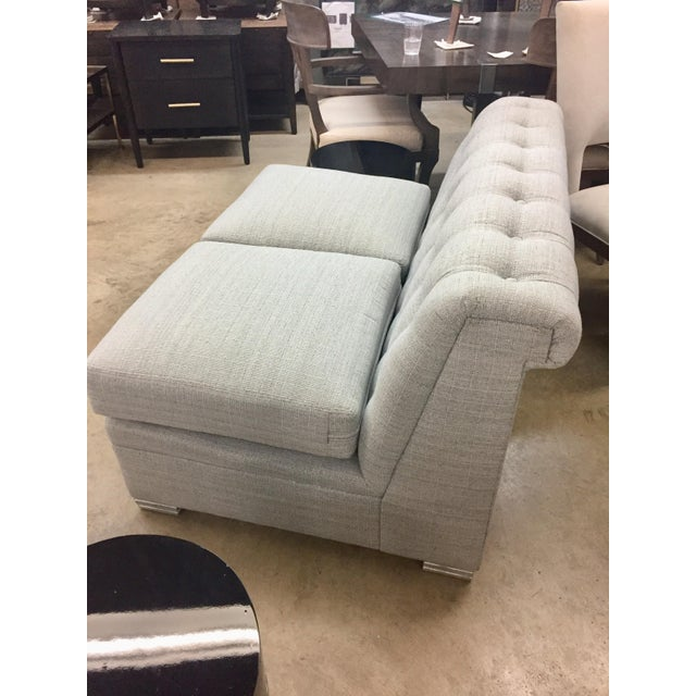 Modern Chesterfield Armless Love Seat fits in all your small spaces. Tufted I'm in back. And sits on a fluted block....