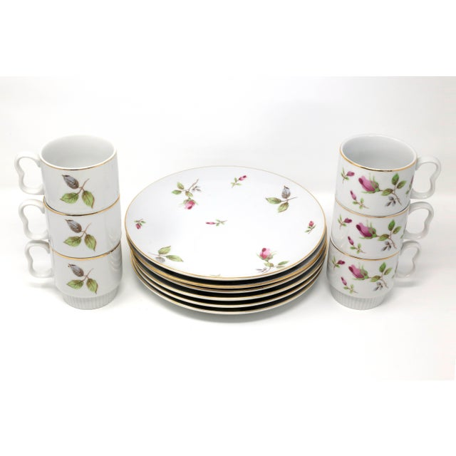 A set of Royal Geoffrey fine china snack plates (6) and stacking cups (6), in a rosebud pattern with gold trim. Excellent...