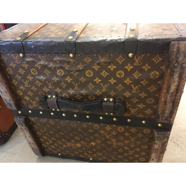 Louis Vuitton wardrobe trunk, with classic monogram exterior. Features include leather handles, beech wood slats, steel...