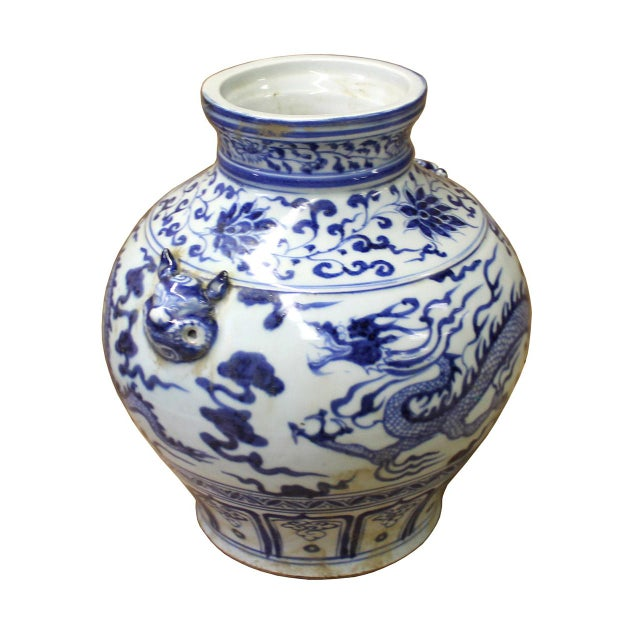 This is a Chinese decorative porcelain vase pot in Blue and White color finish. The theme is oriental dragon scenery...