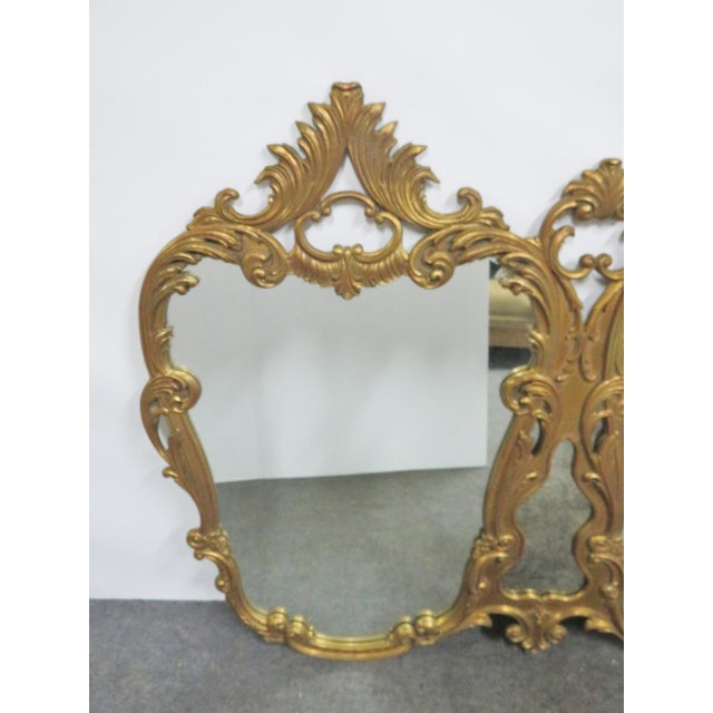 Italian Rococo style multi panel mirror. Carved frame with gold gilt finish.