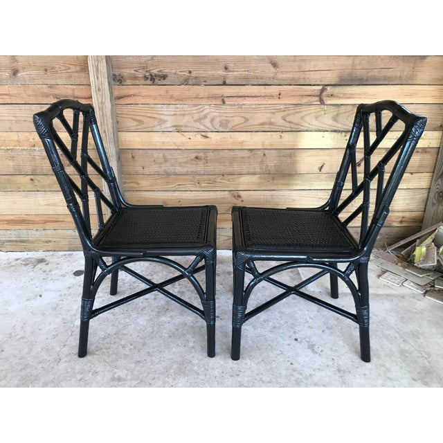 Rattan Black Lacquered Chinese Chippendale chairs ready for cushions. Minor blemishes to the underlying finish that came...