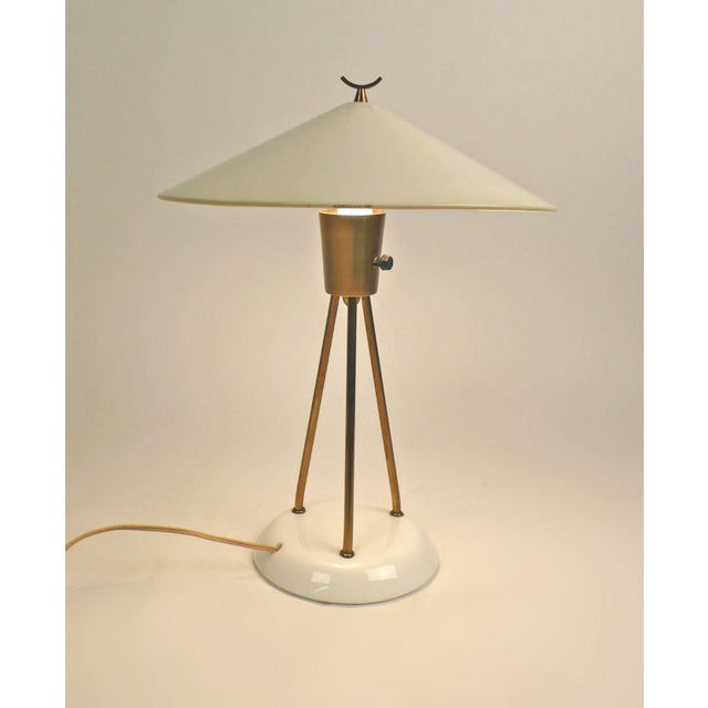 """Rare lightolier """"Coolie Hat"""" lamp with brass tripod supports, vitrolite base and tilt and swivel lacquered metal shade..."""